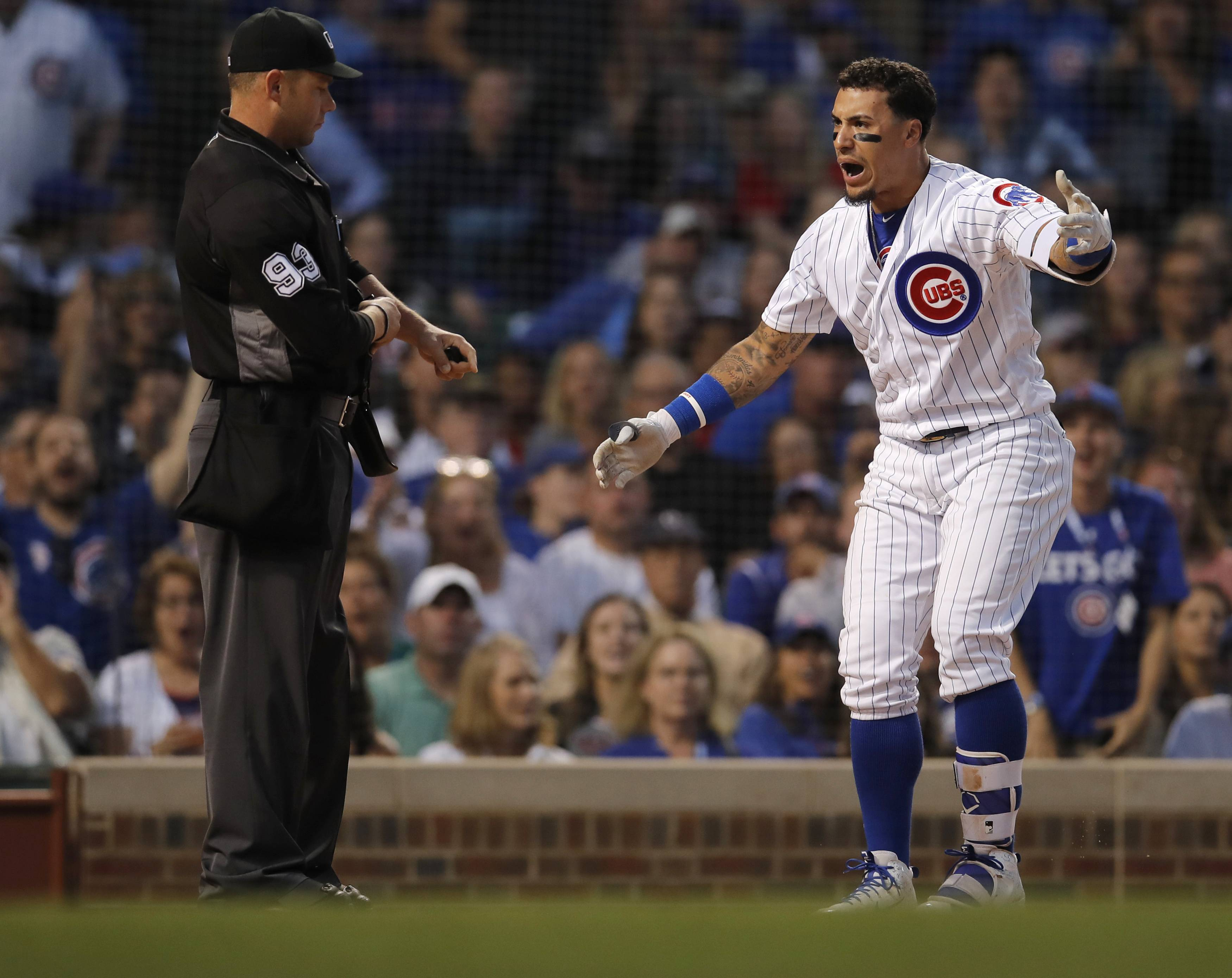 Chicago Cubs' Javier Baez, right, argues a called third strike by home plate umpire Will Little during the fifth inning of the second game of the team's doubleheader against the St. Louis Cardinals Saturday in Chicago.