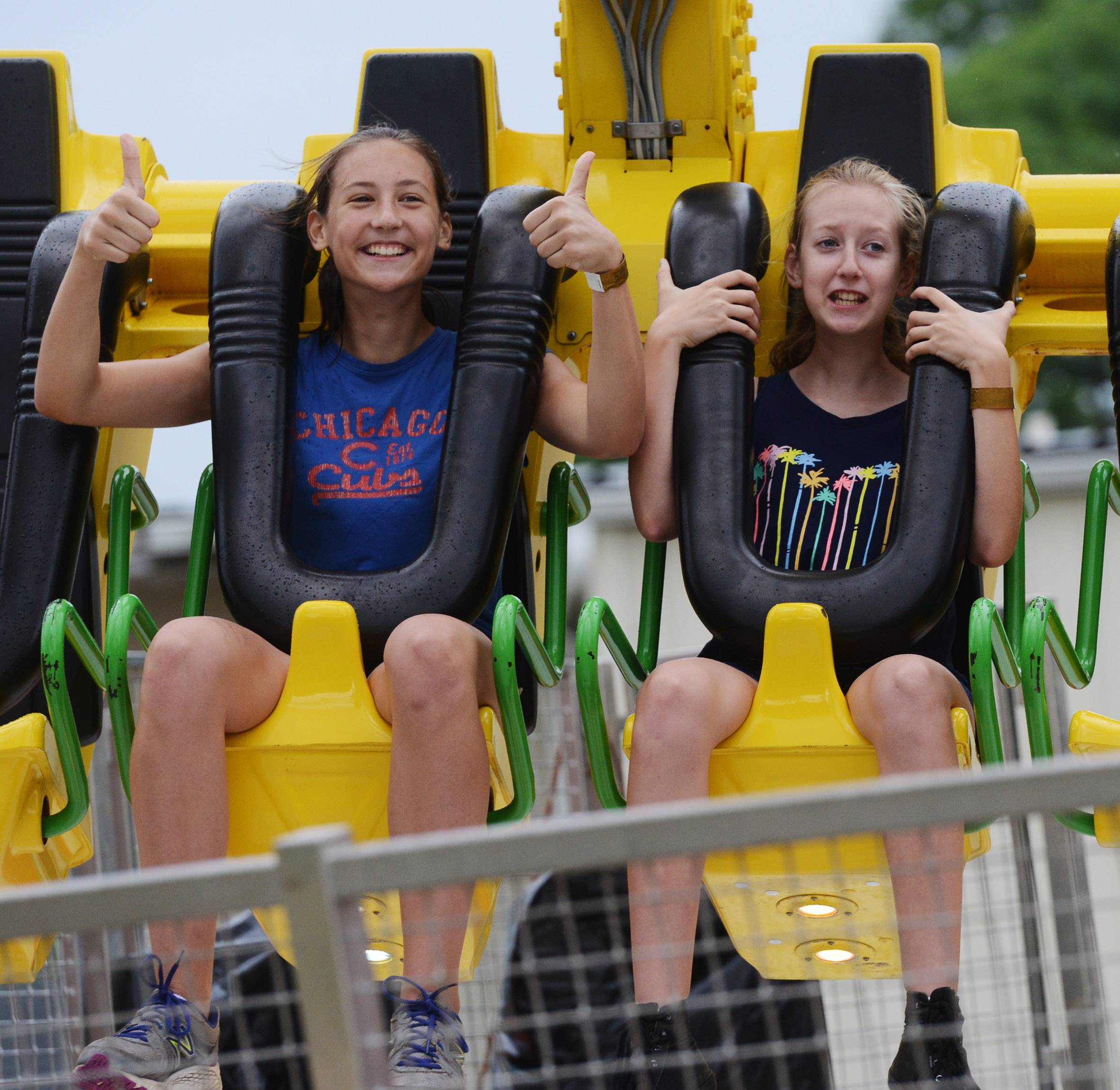 Morgan Evans, 13, of Antioch, and her sister, Jordyn, 12, ride the Super Shot during the Taste of Antioch Saturday.