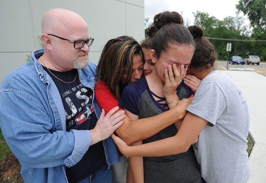 Overwhelmed by the generosity of others, Leslie Gonzalez, 15, middle, is overcome with emotion at The Bridge Community Church in Prospect Heights Saturday as friends James and Juanita Golden with their two children, Kayleen, 13, and Nicole, 15, console her. She and her family, father Lenin, mother Alma and sister Princess, 18, lost everything in Wednesday's fire at the River Trails condominium complex.