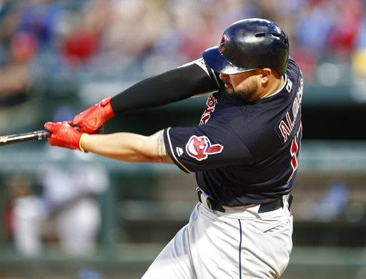 Cleveland Indians' Yonder Alonso follows through on his two-run home run against the Texas Rangers during the fifth inning of a baseball game Saturday, July 21, 2018, in Arlington, Texas.