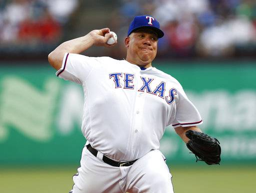 Texas Rangers starting pitcher Bartolo Colon delivers to a Cleveland Indians batter during the first inning of a baseball game, Saturday, July 21, 2018, in Arlington, Texas.