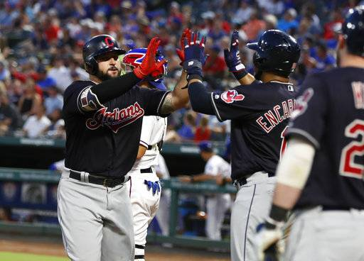 Cleveland Indians' Yonder Alonso, left, celebrates his two-run home run with Edwin Encarnacion during the fifth inning of a baseball game against the Texas Rangers, Saturday, July 21, 2018, in Arlington, Texas.
