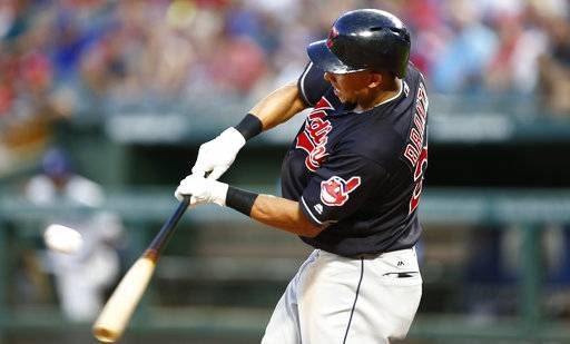 Cleveland Indians' Michael Brantley connects for an RBI-single against the Texas Rangers during the fifth inning of a baseball game, Saturday, July 21, 2018, in Arlington, Texas.