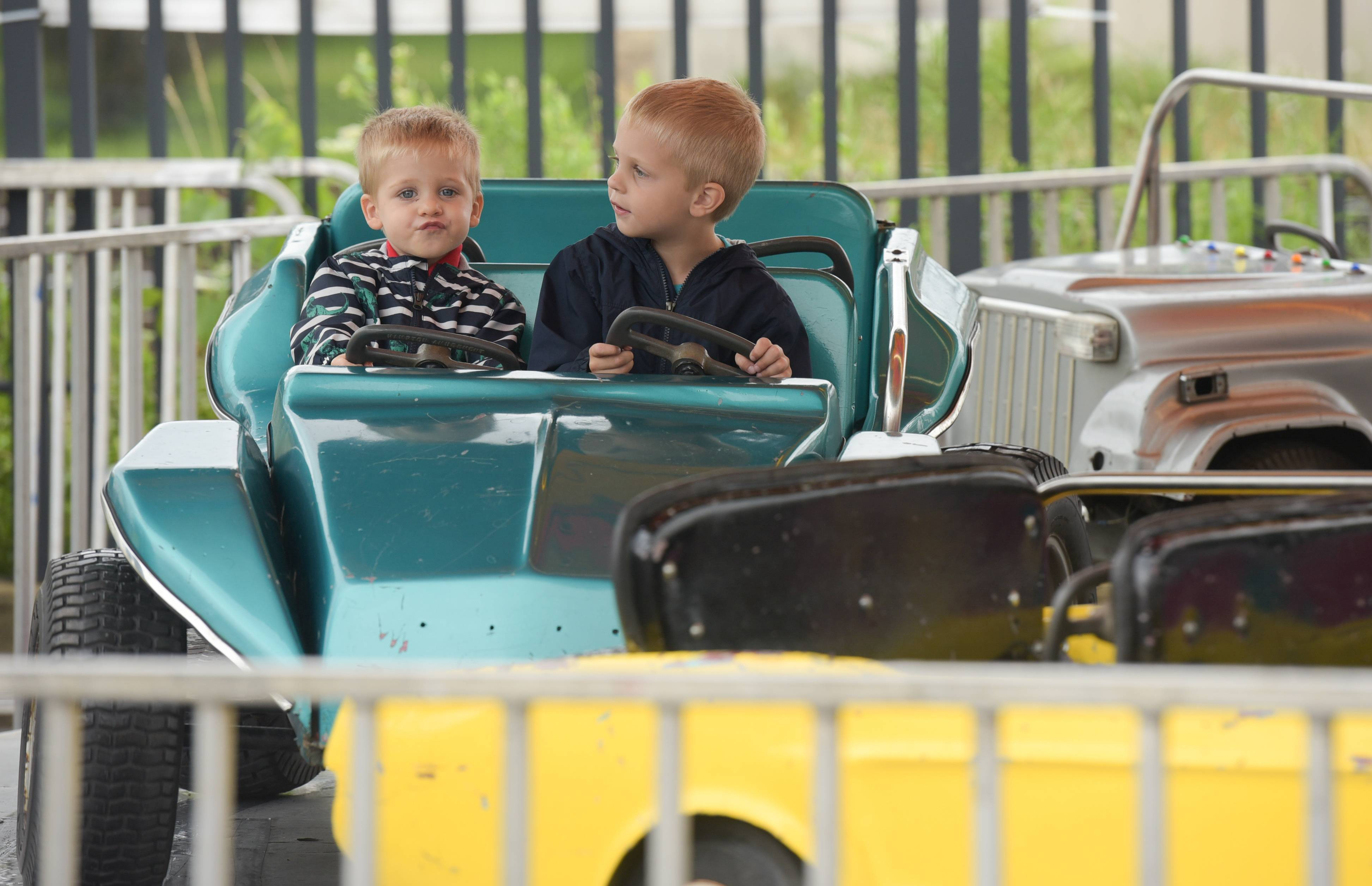 Michael, 2, and Travis, 4, Bruschuk of Villa Park enjoy a carnival ride Sunday during the final day of Germanfest in Lombard. The annual festival is sponsored by Sacred Heart Catholic Church.