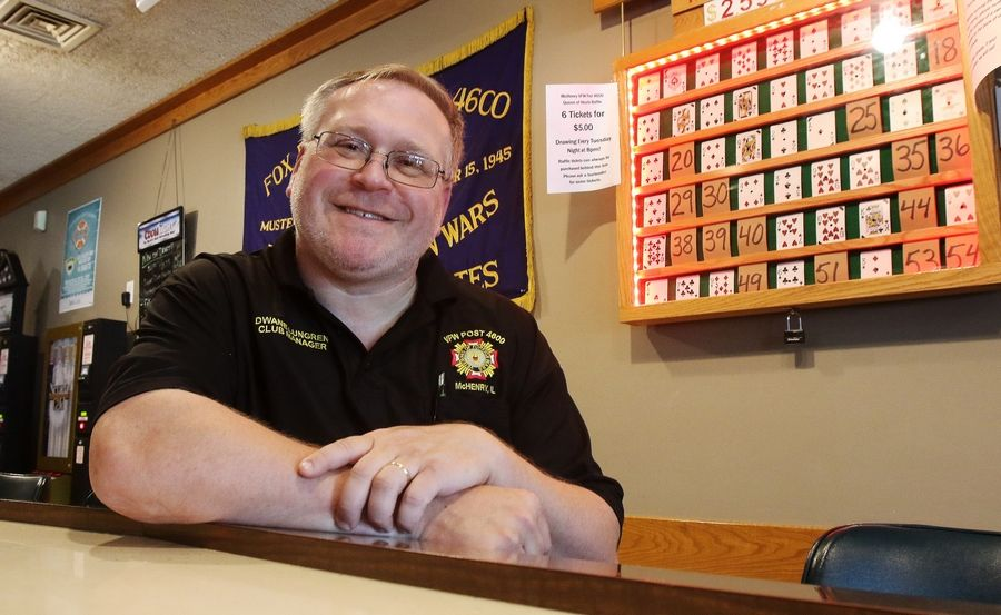 Post Cmdr. Dwane Lungren in front of the board of cards used in the Queen of Hearts raffle drawing at McHenry VFW Post 4600 in McHenry. Tuesday's drawing is for a jackpot of almost $2.6 million.