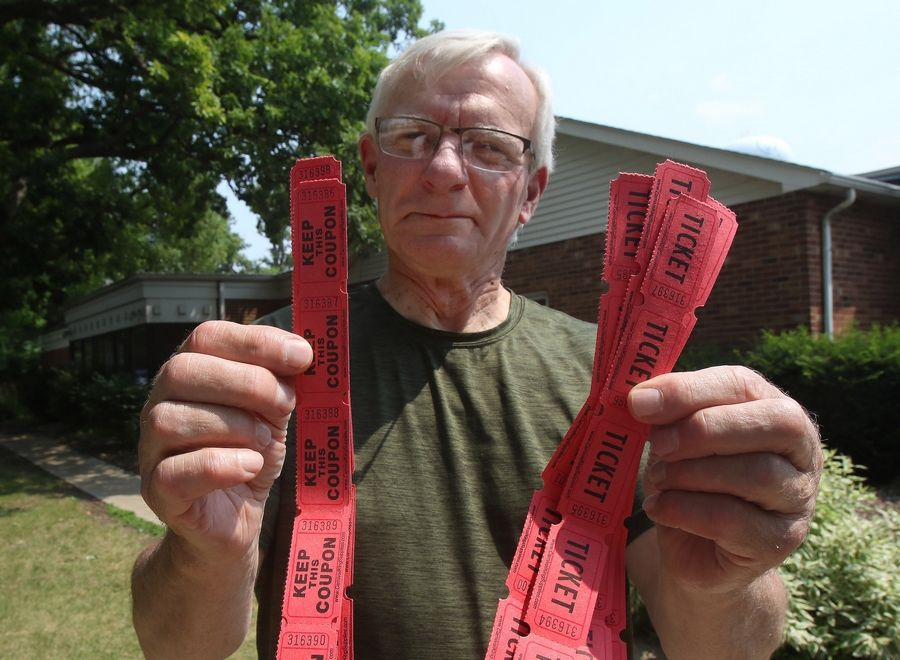 Johnsburg resident Jim Westfall shows off his tickets for Tuesday's Queen of Hearts drawing at McHenry VFW Post 4600 in McHenry.
