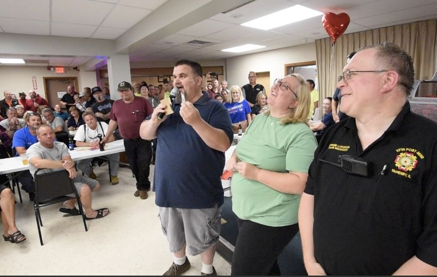 Grayslake resident Kim Kolb reacts as her envelope is revealed to contain not the queen of hearts but the eight of clubs Tuesday during the weekly McHenry VFW Post 4600 drawing.