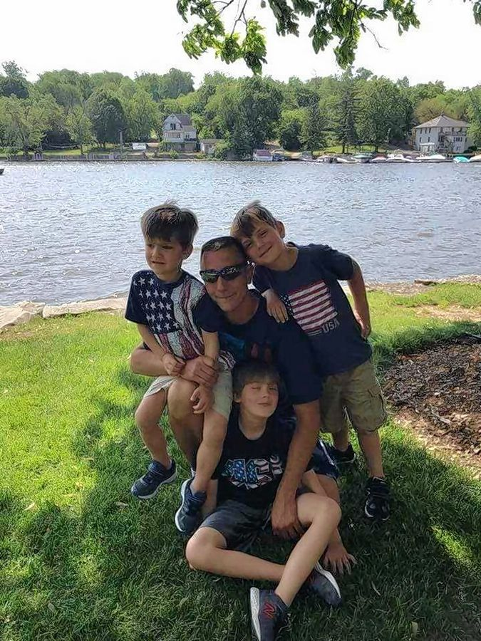 Firefighter/paramedic John-Paul Kilanski, 38, with his three sons, Hunter, middle, Gunnar, right, and Cannon.