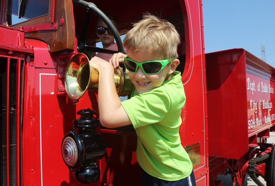 Rocco DeVitto, 7, of Grayslake honks the horn on a 1924 Mac dump truck Tuesday at the Touch-A-Truck event at the Lake County Fairgrounds. The event capped a countywide food drive.