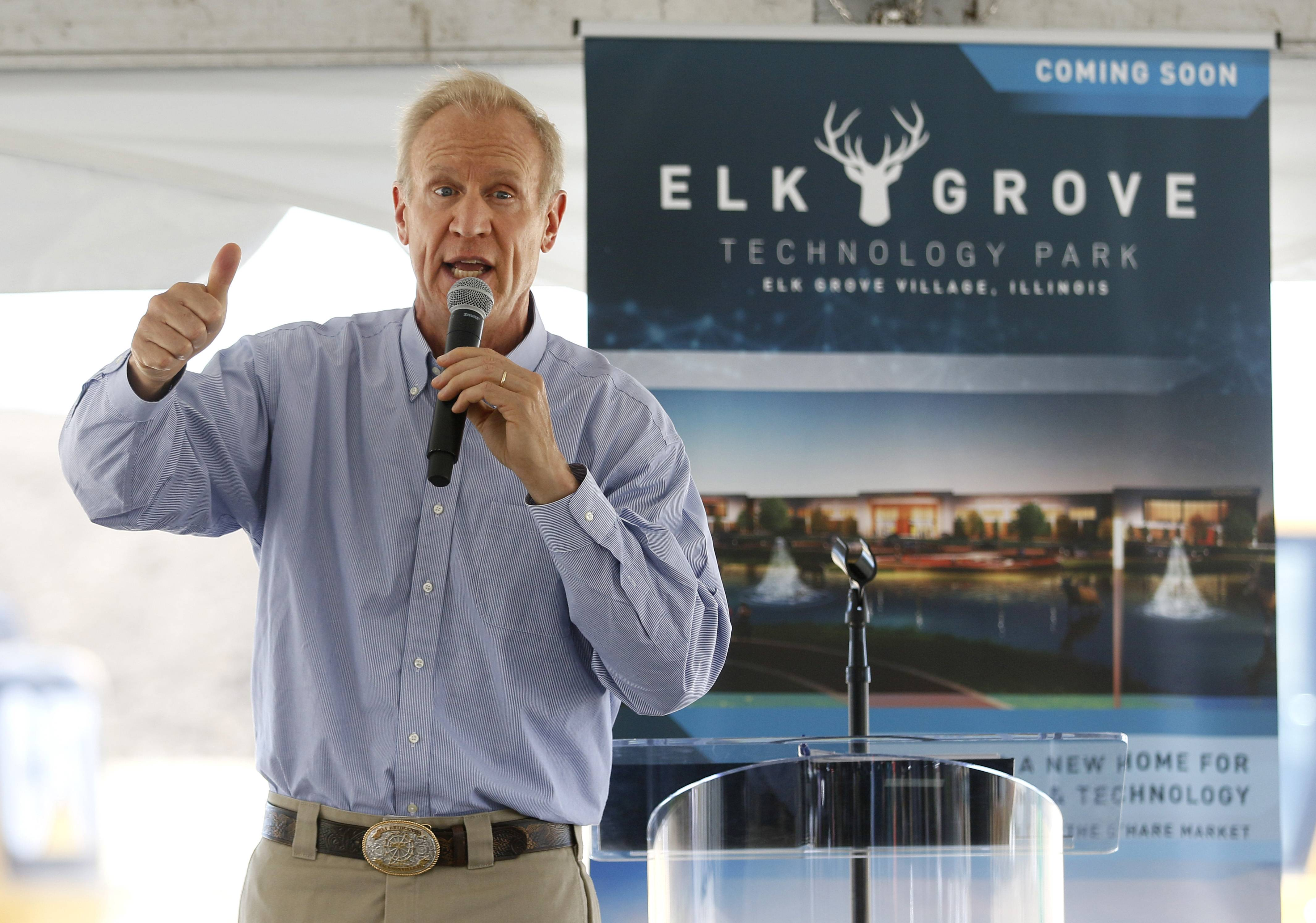 Gov. Bruce Rauner gives the thumbs-up Wednesday during a groundbreaking ceremony for the new $1 billion technology park planned for 85 acres on the north side of Elk Grove Village.