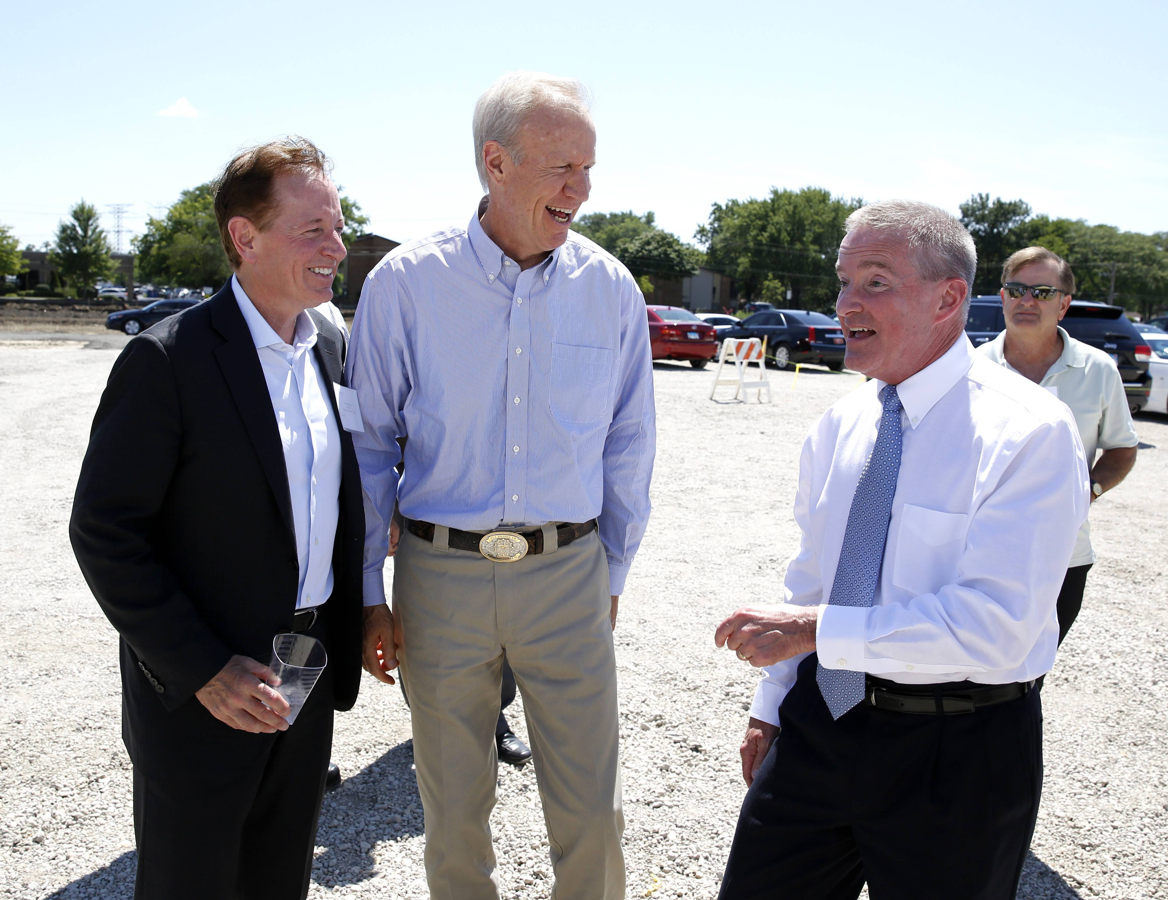 A new $1 billion technology park on 85 acres between East Higgins Road and Oakton Street on the north side of Elk Grove Village is being developed. Above, Michael Brennan, chairman of Brennan Investment Group, Gov. Bruce Rauner and Elk Grove Mayor Craig Johnson talk before a groundbreaking ceremony.