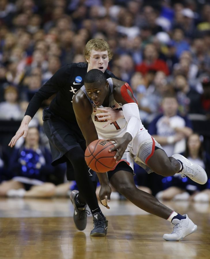 The Bulls signed 6-5 guard Rawle Alkins, foreground, to a two-way contract Wednesday. He spent the past two years at Arizona, averaging 13.1 points and 4.8 rebounds last season.