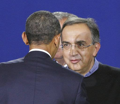 FILE - In this July 29, 2011 file photo, President Barack Obama greets the Fiat Chrysler Group CEO Sergio Marchionne, at the Washington Convention Center in Washington. On Wednesday, July 25, 2018, holding company of Fiat founding family said Sergio Marchionne, who oversaw turnarounds of Fiat and Chrysler, has died.