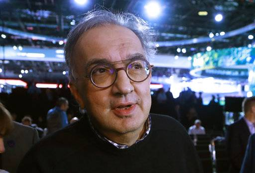 FILE - In this Tuesday, Jan. 16, 2018 filer, Fiat Chrysler Automobiles CEO Sergio Marchionne is interviewed after the unveiling of the new 2019 Jeep Cherokee during the North American International Auto Show, in Detroit. On Wednesday, July 25, 2018, holding company of Fiat founding family said Sergio Marchionne, who oversaw turnarounds of Fiat and Chrysler, has died.