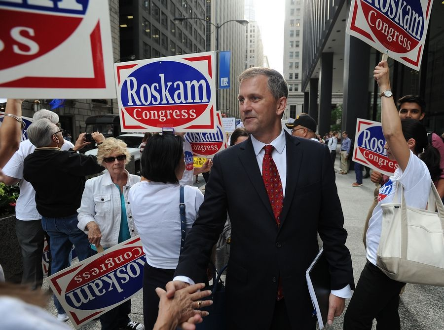 Democratic challenger Sean Casten walks through a crowd supporting his opponent, Republican Rep. Peter Roskam, before a 6th Congressional District forum hosted Thursday in Chicago by Fox 32 news.