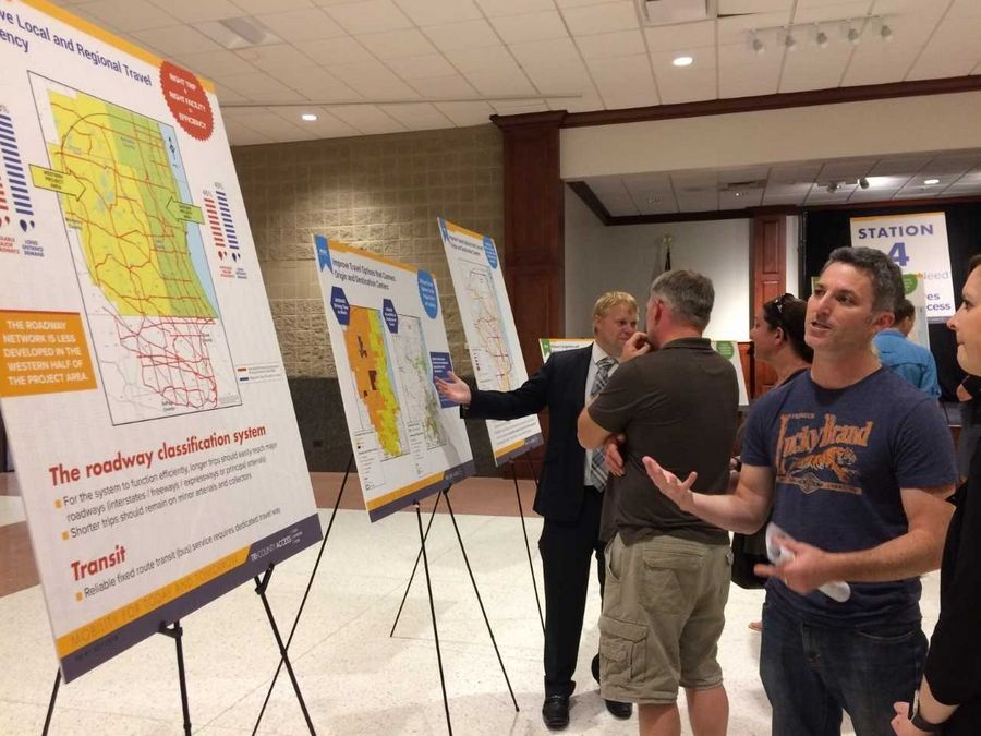 Visitors examine exhibits Wednesday during the first Tri-County Access Project open house. The study area is 1,000 square miles in Lake, eastern McHenry and northern Cook counties.
