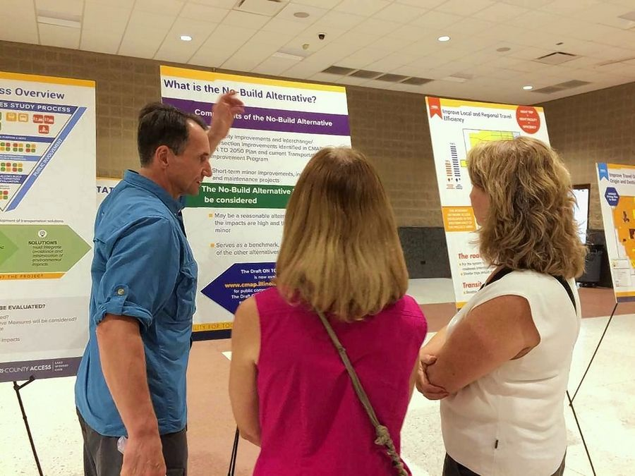 Visitors examine exhibits Wednesday during the first open house of the Tri-County Access Project, a $25 million study of transportation options funded by the tollway.