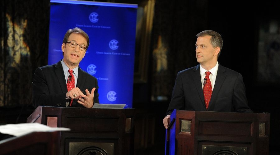 Republican Rep. Peter Roskam debates Democratic challenger Sean Casten on Thursday in Chicago. The two are running in a 6th Congressional District race described as one of the most-watched campaigns in the country.