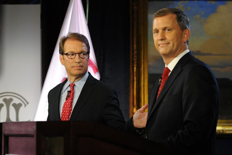 "Democratic challenger Sean Casten of the 6th Congressional District, right, says during a forum Thursday at the Union League Club of Chicago that his campaign against incumbent Republican Peter Roskam comes down to ""facts and character."""