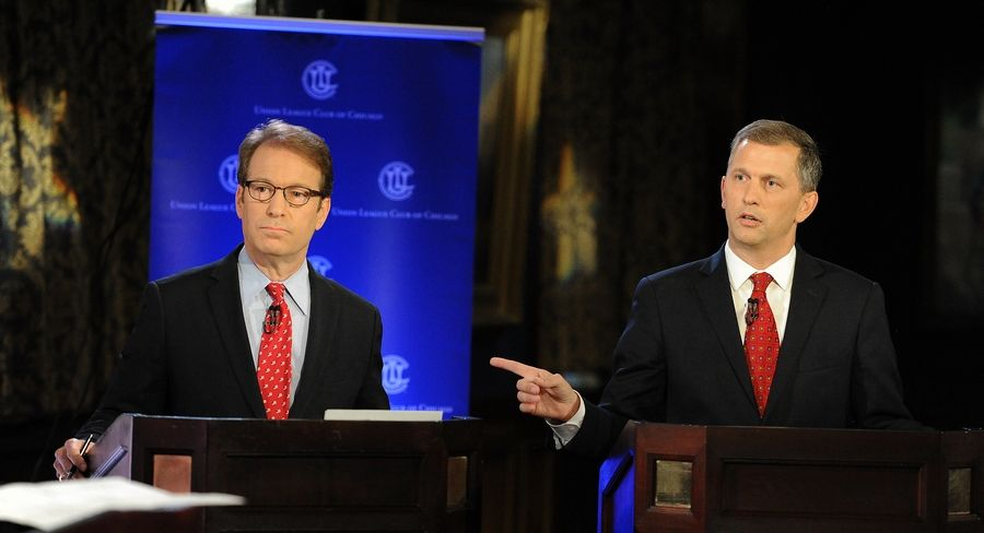 Democratic challenger Sean Casten, right, points out issues with Republican Rep. Peter Roskam's actions on health care during a 6th Congressional District debate Thursday at the Union League Club of Chicago.