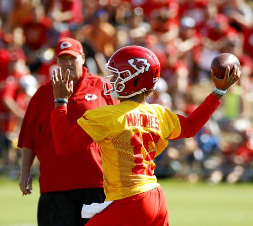Kansas City Chiefs quarterback Patrick Mahomes (15) throws during NFL football training camp Thursday, July 26, 2018, in St. Joseph, Mo.