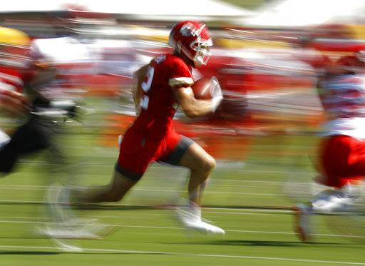 Kansas City Chiefs wide receiver Gehrig Dieter runs with the ball during NFL football training camp Thursday, July 26, 2018, in St. Joseph, Mo.