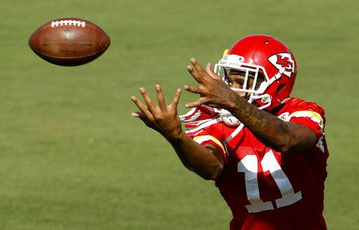 Kansas City Chiefs wide receiver Demarcus Robinson catches a ball during NFL football training camp Thursday, July 26, 2018, in St. Joseph, Mo.