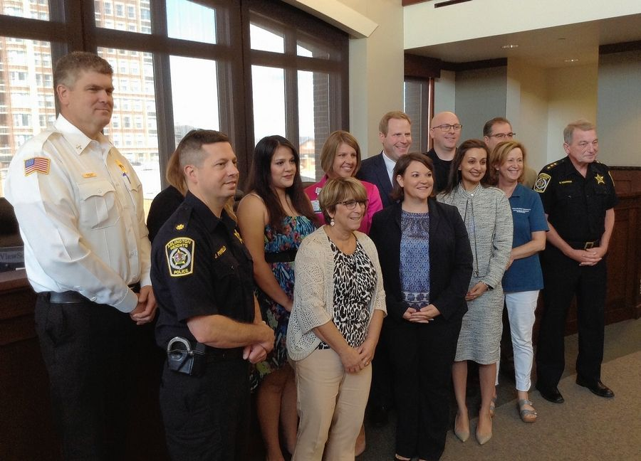 Arlington Heights officials and leaders of community agencies came together Thursday at village hall to formally launch a program to assist residents struggling with opioid addiction.