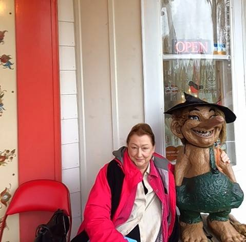Susan Anderson-Khleif poses with a troll in the Norwegian village of Mt. Horeb, Wisconsin.