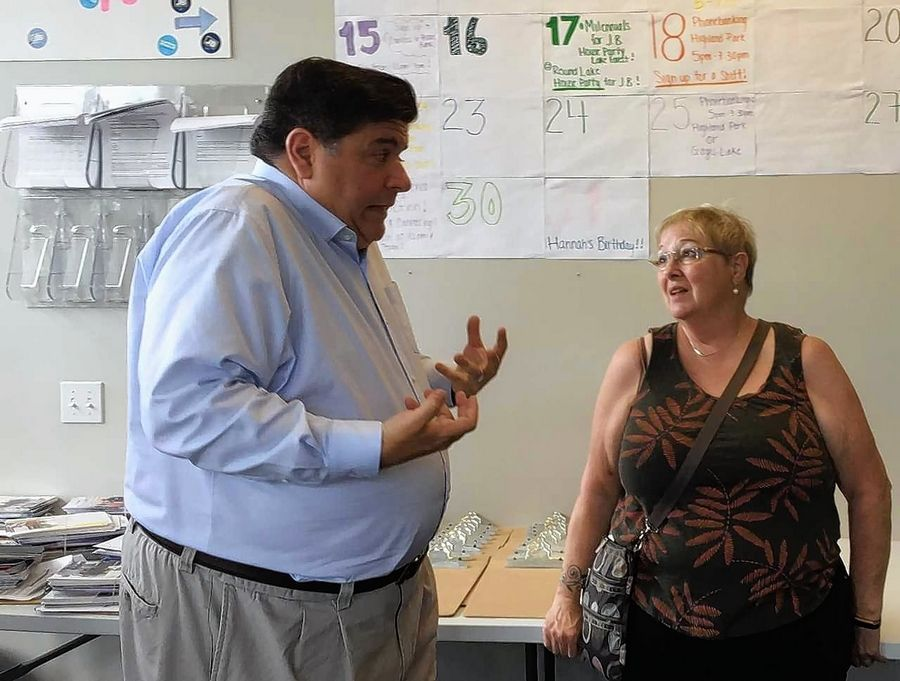 Democratic candidate for governor J.B. Pritzker talks issues with a supporter Saturday during a stop at a campaign office in Gurnee.