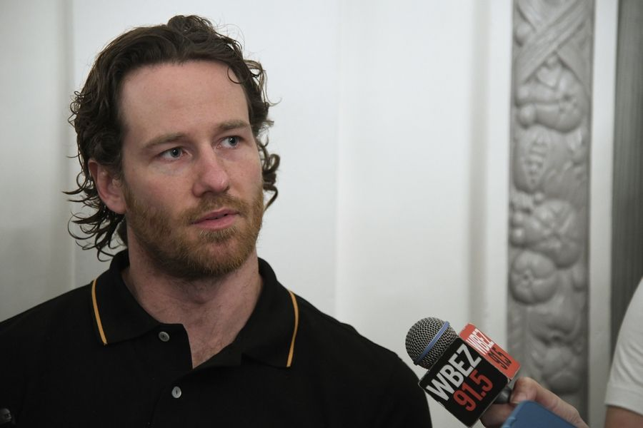 Chicago Blackhawks' Duncan Keith speaks to a reporter during the NHL hockey team's convention Friday, July 27, 2018, in Chicago.