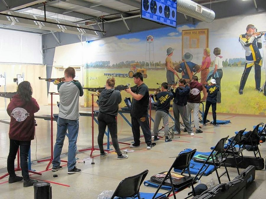Wheeling High School Navy Junior ROTC cadets participate in a marksmanship meet last November. Northwest Suburban High School District 214 is among the few suburban school districts to offer ROTC.