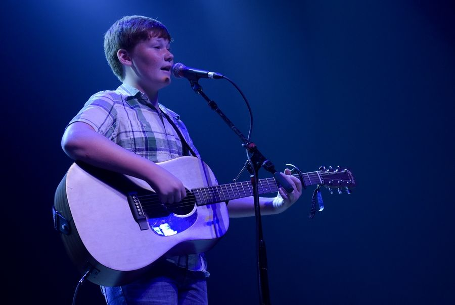 "Joey Wilbur, 13 of St. Charles performs his original song ""2,000 miles"" during the semifinals of the 2018 Suburban Chicago's Got Talent on Sunday at Arcada Theatre in St. Charles."