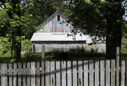 The logo of President Barack Obama's 2008 presidential campaign fades on a barn in Elkhart County, Ind., on Friday, June 1, 2018. In the county that voted nearly two-thirds for Donald Trump, a grass-roots campaign by local residents voiced enough opposition to scuttle the building of an immigration detention center nearby.