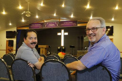 Pastors Jose Luis Gutierrez, left, from the Comunidad Cristiana Adulam church and Neil Amstutz from the Waterford Mennonite Church, pose for a portrait at Gutierrez's church on Friday, June 1, 2018. In late 2017, they invited clergy from around the county to Adulam and the group made plans for a community-wide service to oppose the immigration detention center.