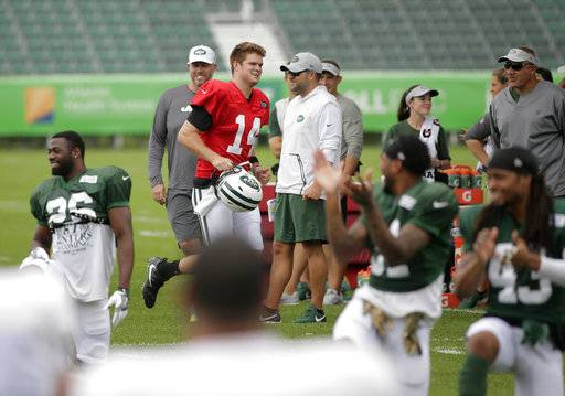 06dc04c0a Teammates clap as Sam Darnold (14) arrives for NFL football training camp  practice in