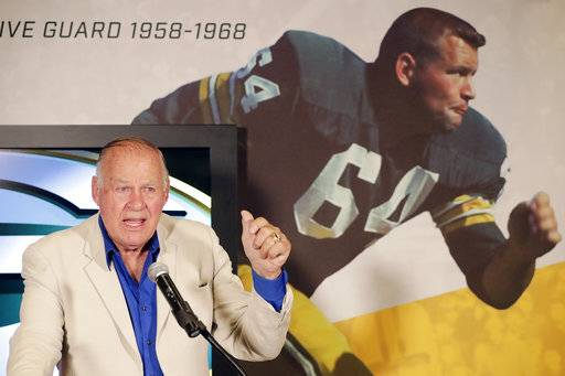 In this July 25, 2018, photo, former Green Bay Packers NFL football player Jerry Kramer speaks at the opening of an exhibit featuring his Packers career at the Green Bay Packers Hall of Fame at Lambeau Field in Green Bay, Wis. Kramer will be inducted into the Pro Football Hall of Fame on Saturday, Aug. 4, 2018, in Canton, Ohio. (Adam Wesley/The Green Bay Press-Gazette via AP)