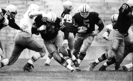 FILE - In this undated file photo, Green Bay Packers' Jerry Kramer (64) blocks for Paul Hornung (5) during a football game in Green Bay, Wisc. Kramer will be inducted into the Pro Football Hall of Fame on Saturday, Aug. 4, 2018, in Canton, Ohio.