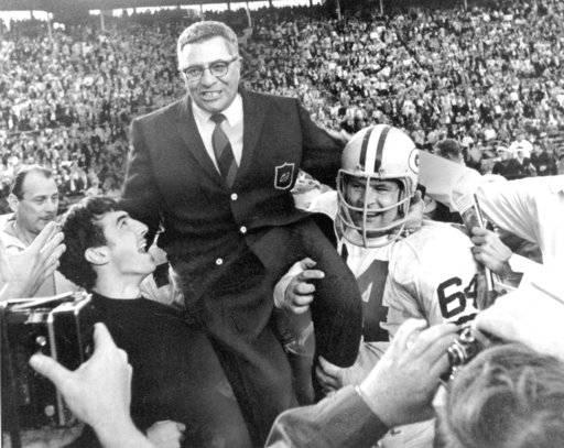 FILE - In this Jan. 14, 1968, file photo, Green Bay Packers coach Vince Lombardi is carried off the field after his team defeated the Oakland Raiders 33-14 in Super Bowl II in Miami, Fla. Packers guard Jerry Kramer (64) is at right. Kramer will be inducted into the Pro Football Hall of Fame on Saturday, Aug. 4, 2018, in Canton, Ohio.