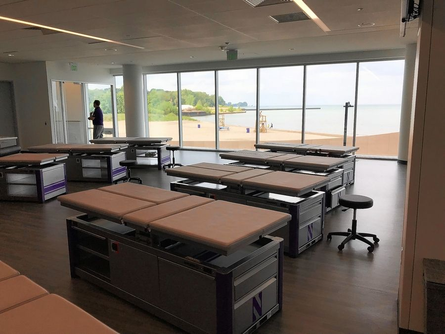 The training room at Northwestern's new Walter Athletics Center in Evanston looks out at the beach fronting its Lake Michigan shoreline.