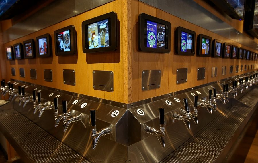 "Red Arrow Tap Room in downtown Naperville features a ""beer wall"" with 48 self-service taps for beer, wine and cider. The restaurant plans to open in the coming weeks at 216 S. Washington St."