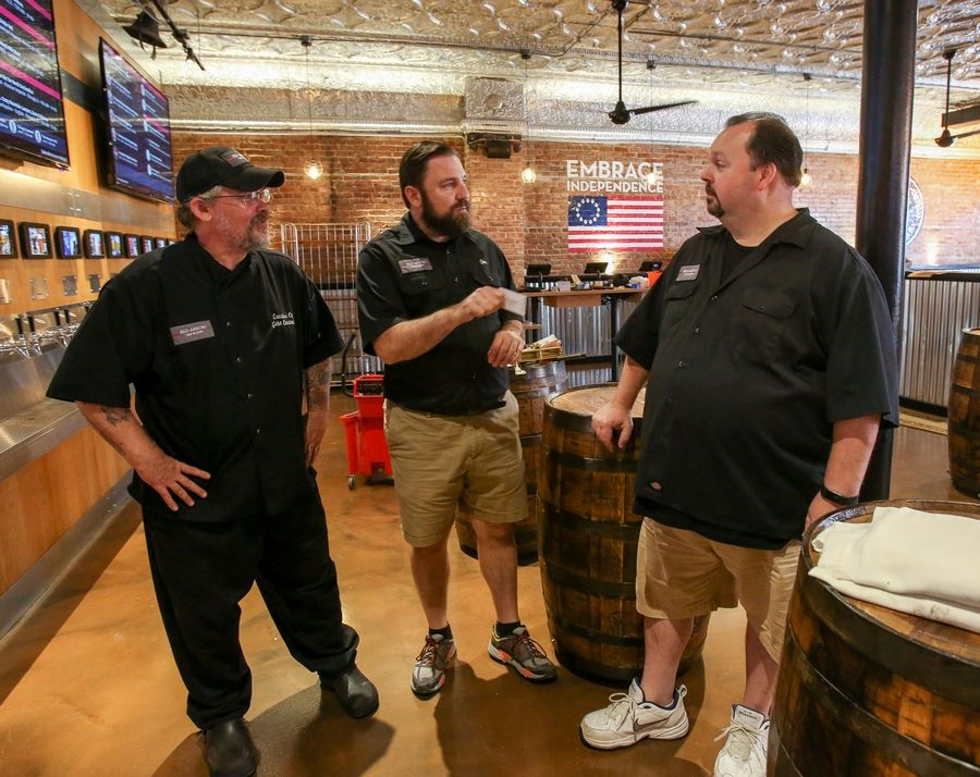 Executive Chef John Cardamone, founder and CEO Joseph Tota and General Manager Russ Hillard are the leaders of the new Red Arrow Tap Room, which is set to open in the next few weeks in downtown Naperville.