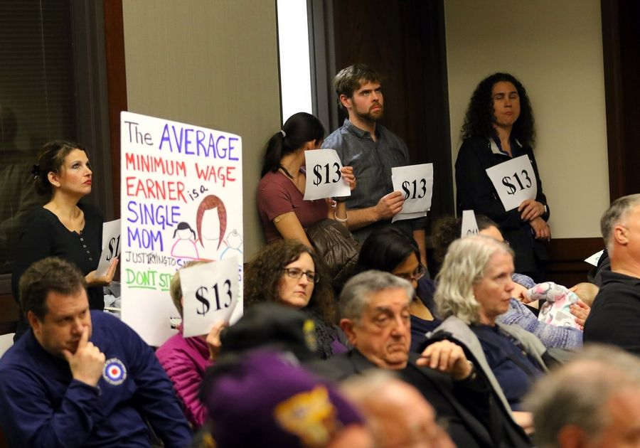 People show their support for Cook County's minimum-wage and sick-leave ordinances as the Arlington Heights village board voted to opt out of them in June 2017.