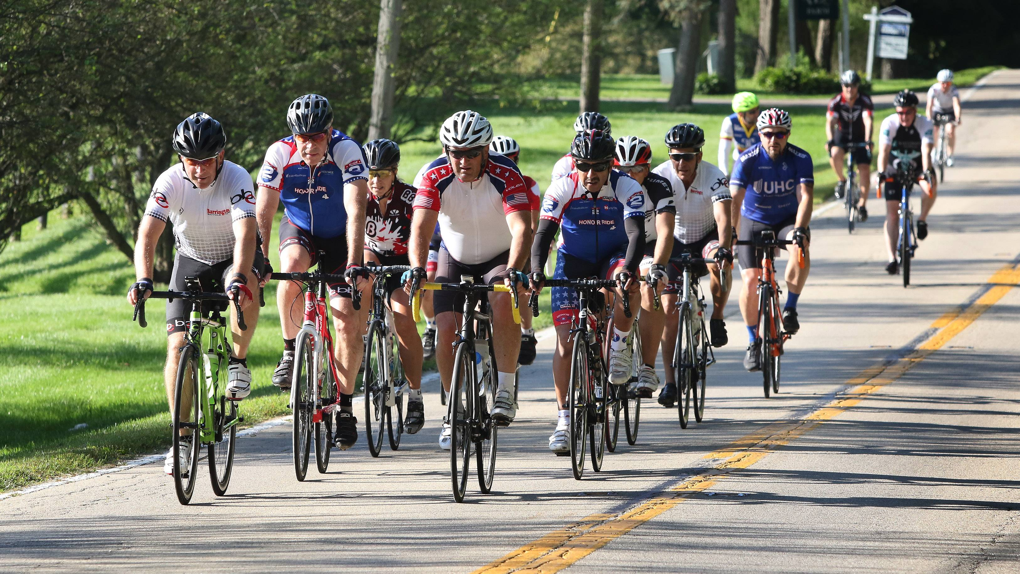 Cyclists make their way along Old Sutton Road during the 2017 Project Hero Barrington Honor Ride in Barrington Hills last August. The 2018 ride is scheduled for Aug. 12.