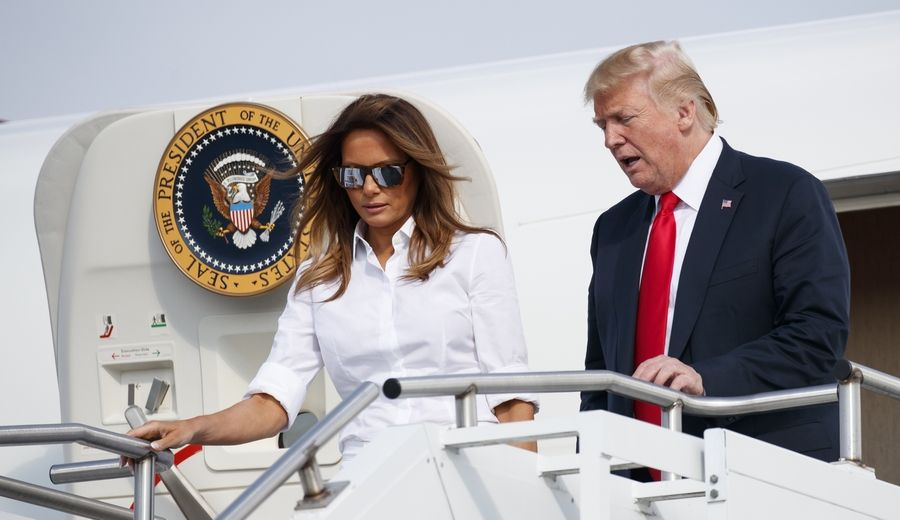 President Donald Trump and first lady Melania Trump arrive last month on Air Force One in Morristown, New Jersey, en route to Trump National Golf Club in Bedminster, New Jersey.