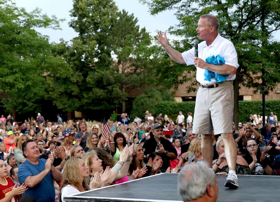 Elk Grove Village Mayor Craig Johnson announced to those gathered for a summer concert Tuesday night that the village will be sponsoring the Bahamas Bowl game Dec. 21.