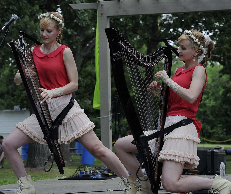 Camille and identical twin sister Kennerly Kitt of Chicago entertain fans and fairies Sunday at the World of Faeries Festival in South Elgin. They play electric/acoustic harps as the Harp Twins.