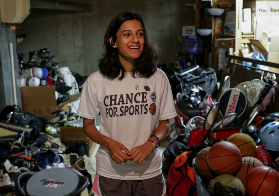 Anuva Shandilya, 17, of Naperville has collected more than 3,400 pieces of sports equipment to donate to kids in need through a nonprofit organization she created three years ago called Chance for Sports.