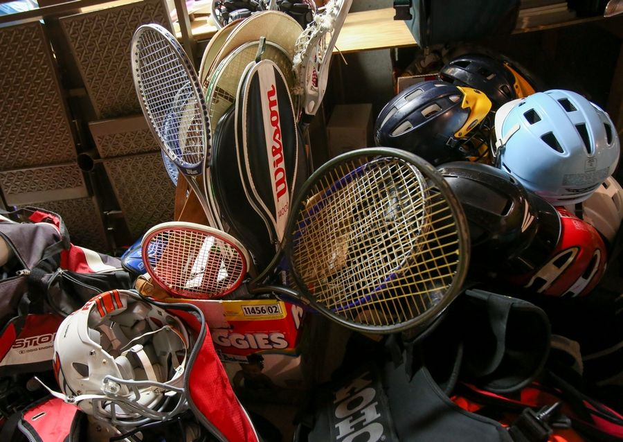 Tennis rackets and helmets for biking and football are among the more than 3,400 pieces of used sporting equipment Anuva Shandilya of Naperville has collected to distribute through a nonprofit organization she created called Chance for Sports.