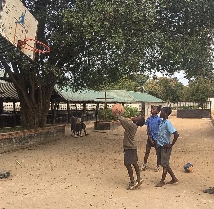 Children at a school in Zambia play basketball in November 2017 with donated gear from Naperville-based Chance for Sports. An organization called Lifesong for Orphans helped Anuva Shandilya, founder of Chance for Sports, facilitate the donation.